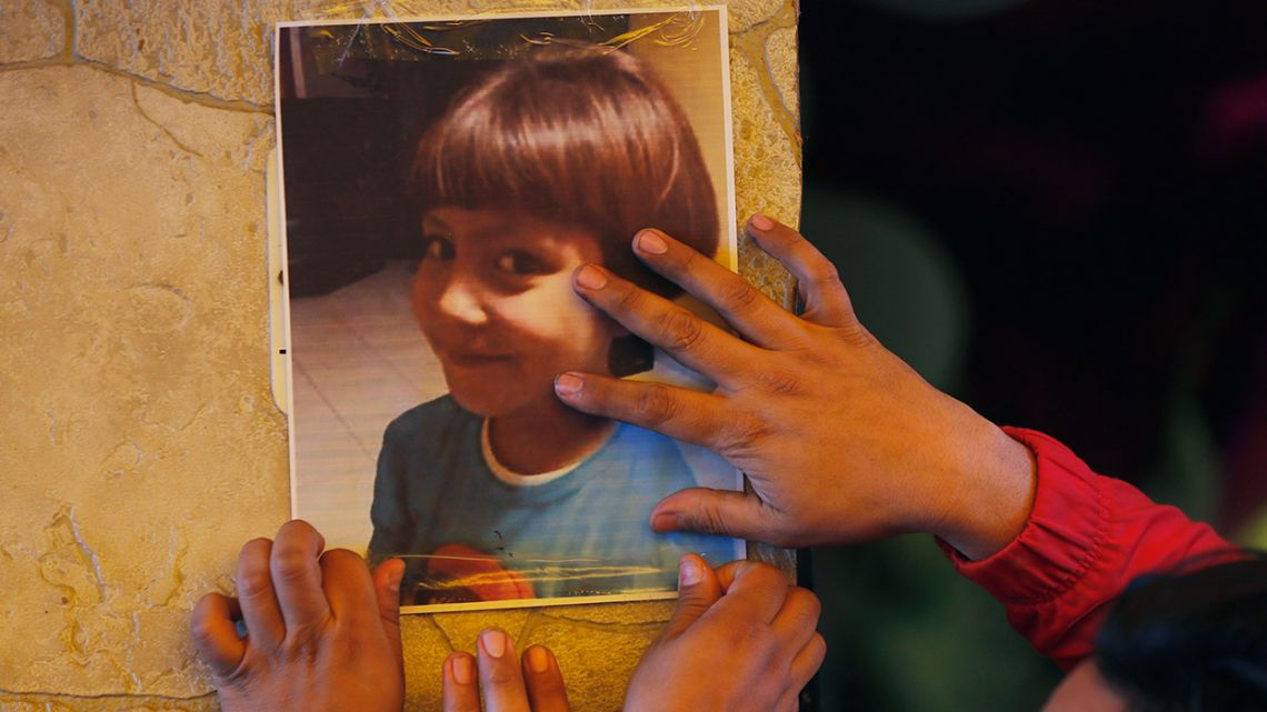 Relatives post a photo of Fatima, a 7-year-old girl who was abducted from the entrance of the Enrique C. Rebsamen primary school in Mexico City.