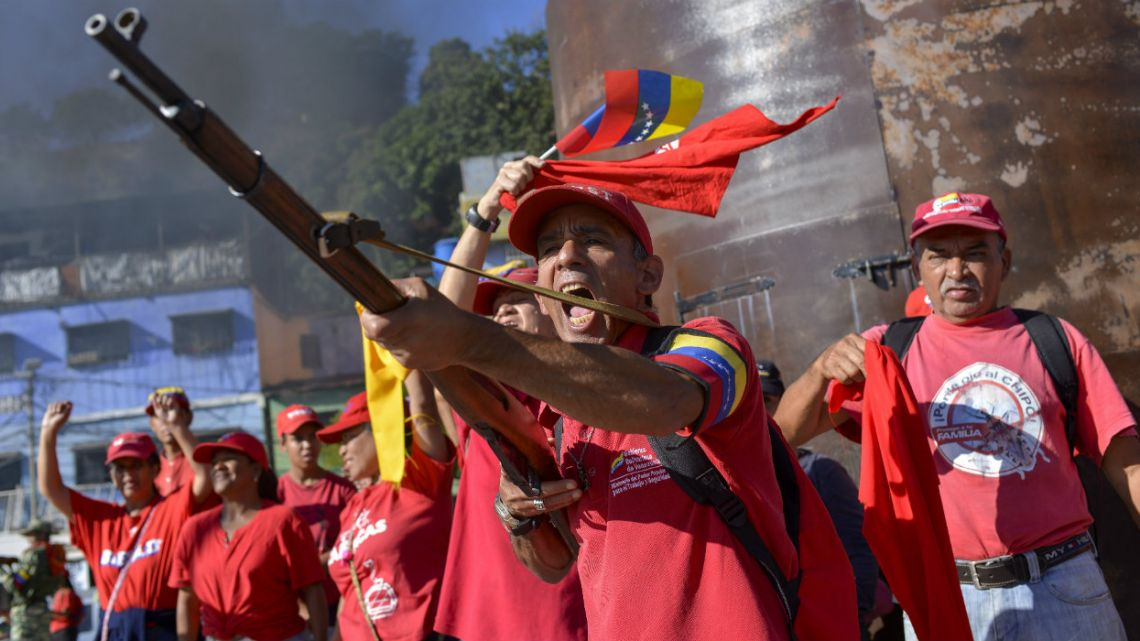 A member of the Bolivarian National Militia brandishes a rifle during an invasion drill in Caracas, Venezuela.