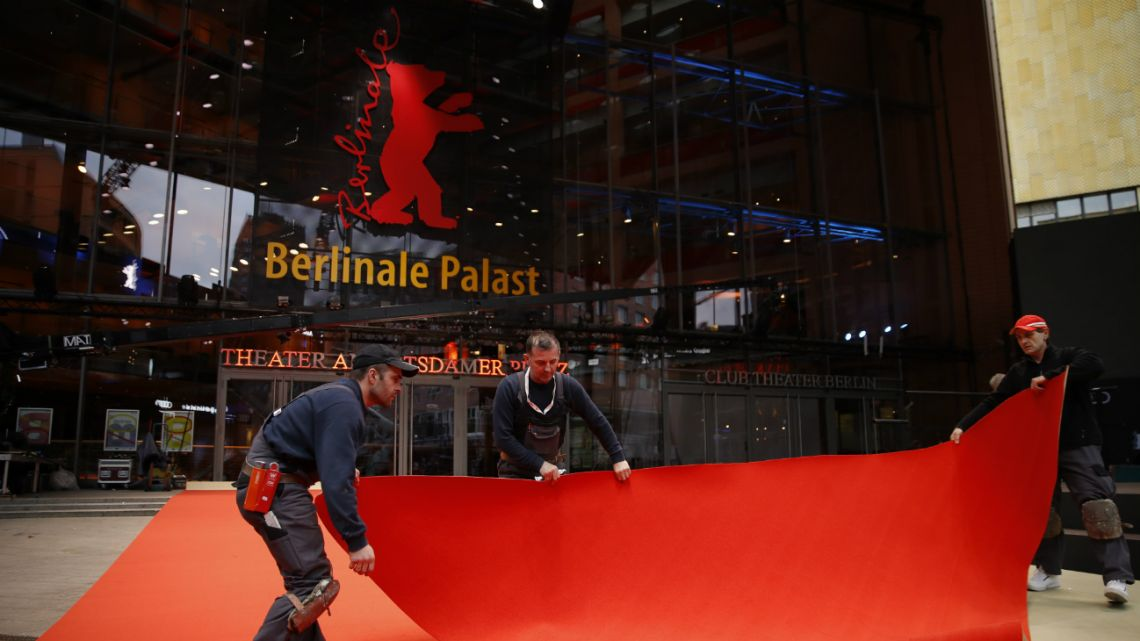 Workers set up the red carpet on February 18, 2020 at Berlinale Palace in Berlin, prior to the opening of the Berlinale film festival.