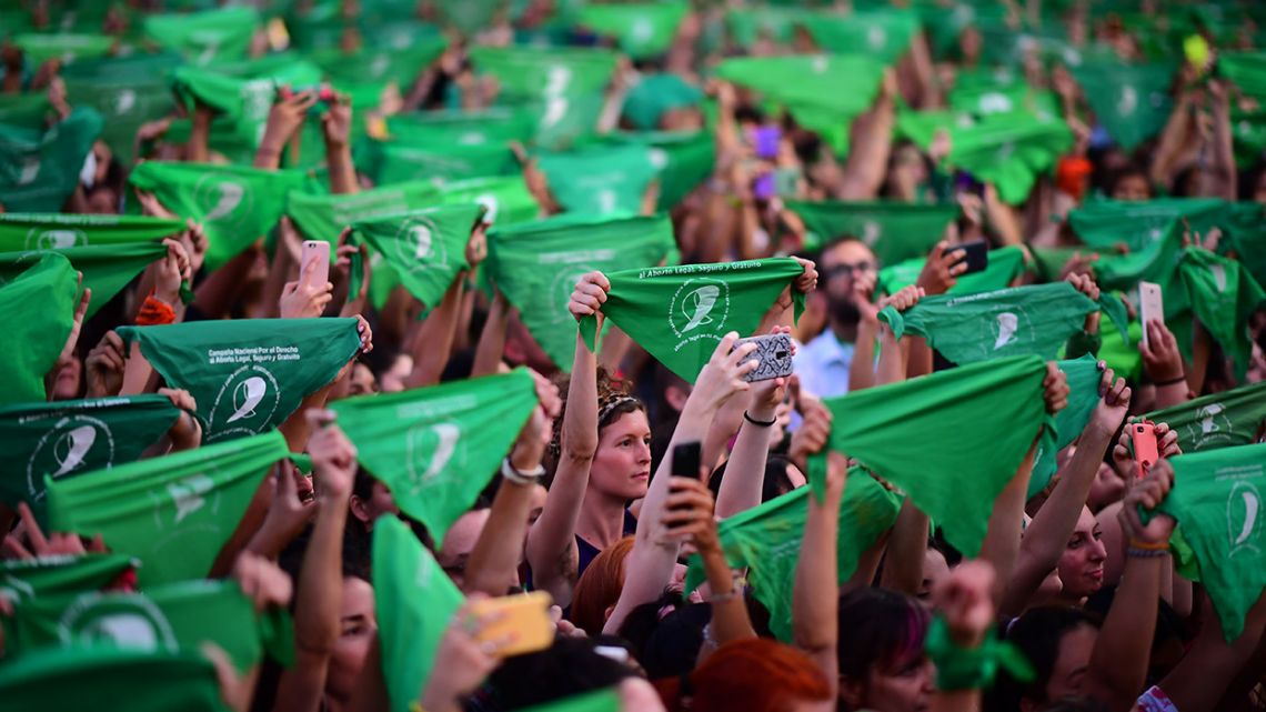 Thousands of women hold up green scarves demanding abortion reform in Buenos Aires on February 19, 2020.