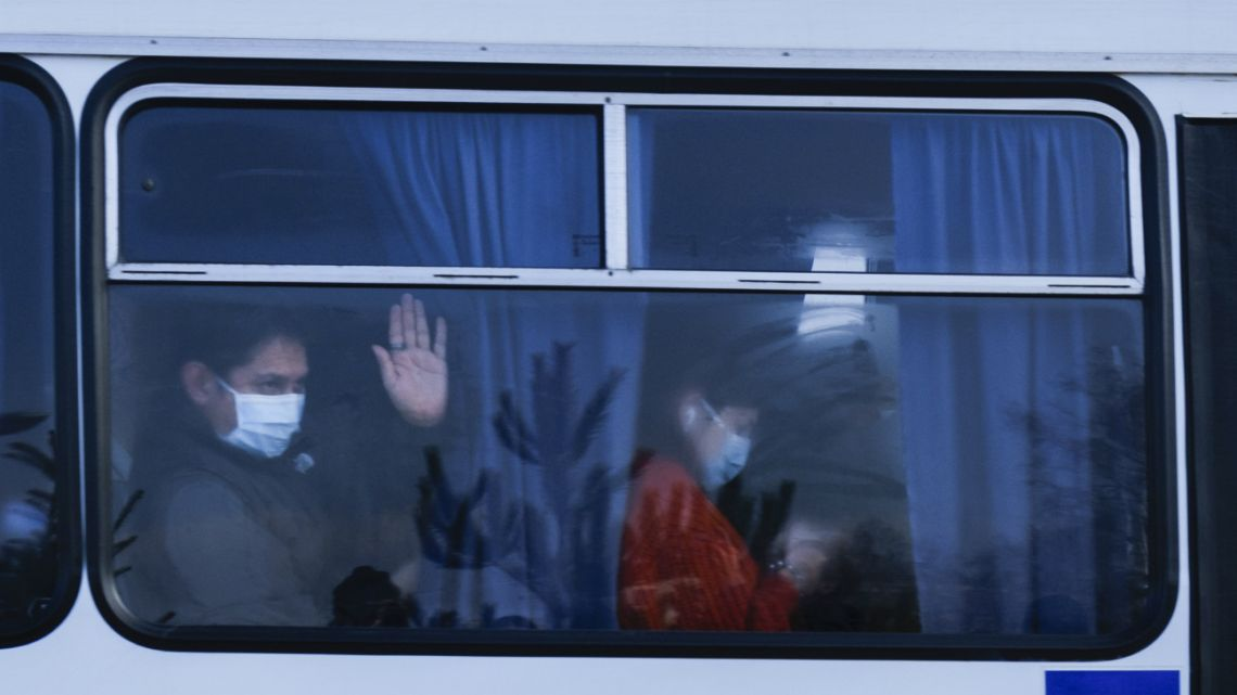 Busses with passengers from the Ukrainian aircraft supposed to evacuate from the Chinese city of Wuhan, leave the the gate upon their landing at airport outside Kharkiv, Ukraine, on February 20, 2020.