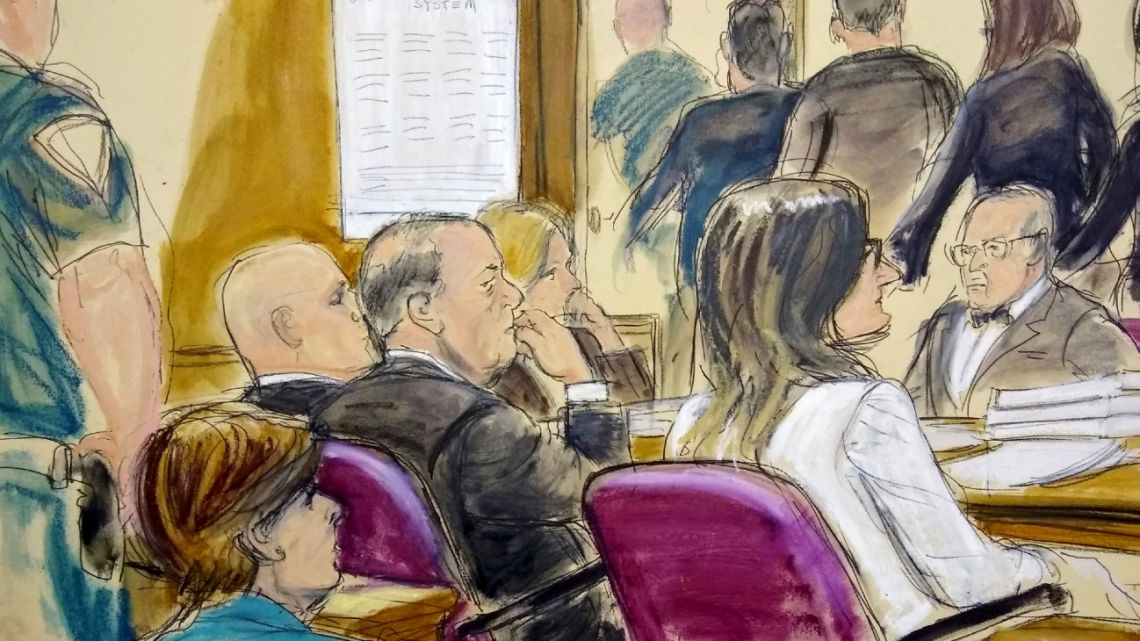 In this courtroom drawing, Harvey Weinstein, center, sits at the defense table surrounded by his attorneys as jurors file out of the courtroom after being told by the judge to go back and keep deliberating in Weinstein's rape case, Friday, February 21, 2020, at Manhattan Supreme Court in New York.