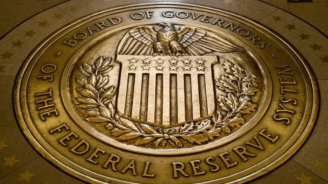 The seal of the Board of Governors of the United States Federal Reserve System at the Marriner S. Eccles Federal Reserve Board Building in Washington, on February 2018.