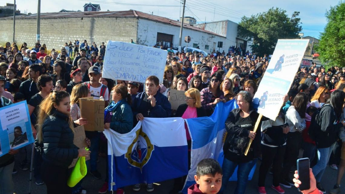 Residents of Puerto Deseado march to demand justice after the rape of Maria Santino and the crime of her 4-year-old son.