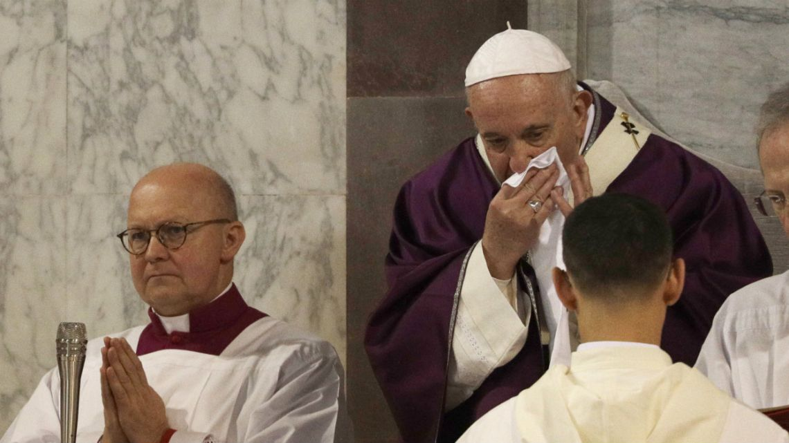 Pope Francis wipes his nose during the Ash Wednesday Mass opening Lent.