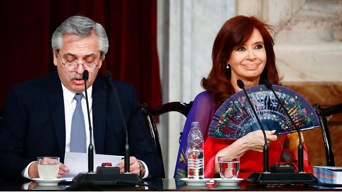 Alberto Fernández, left, speaks as Vice-President Cristina Fernández de Kirchner uses a fan to keep cool, as the president opens the 2020 sessions of Congress, Sunday, March 1, 2020.