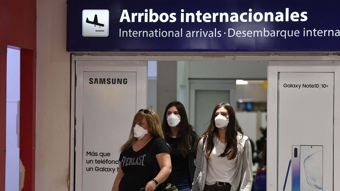 Passengers exit Ezeiza international airport using face masks, in a bid to protect themselves against coronavirus.