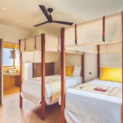 La confortable habitación de Miches mantiene la elegancia y el estilo Club Med.