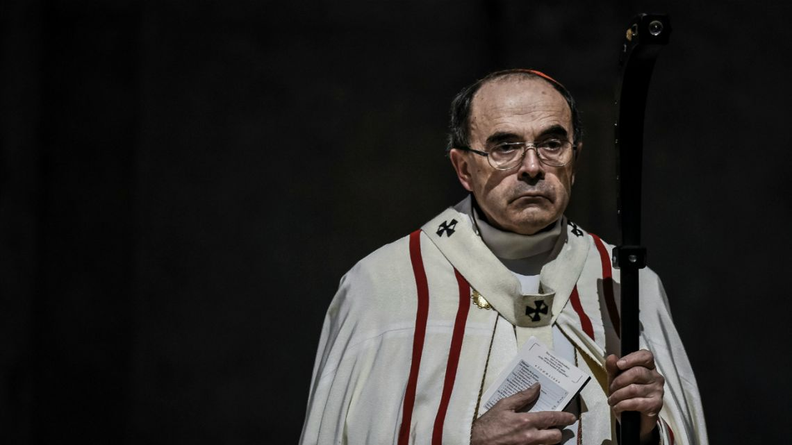 In this file photo taken on April 3, 2016 Roman Catholic Cardinal, Archbishop of Lyon, Philippe Barbarin leads a mass, in Saint-Jean cathedral in Lyon.