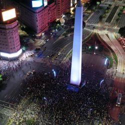 Boca Juniors fans begin to arrive at the Obelisco for celebrations after clinching the title.