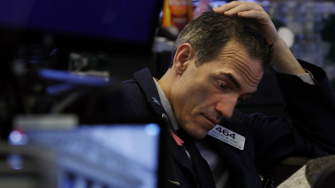 Trading in Wall Street futures has been halted after they fell by more than the daily limit of 5 percent.