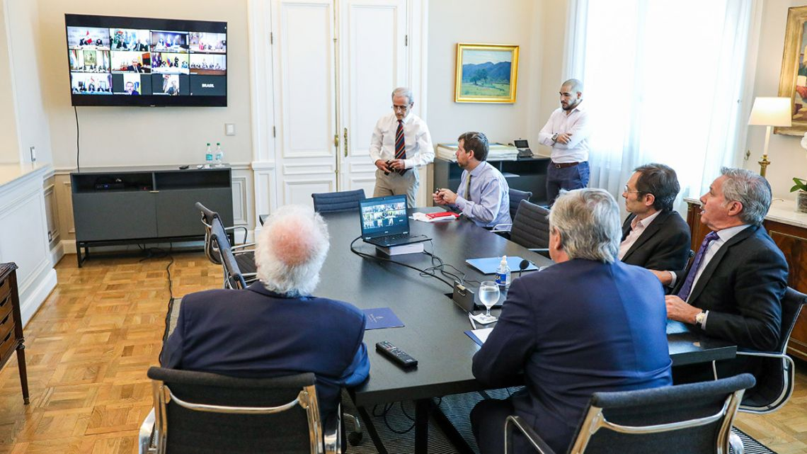 Handout picture released by the Presidency shows President Alberto Fernández (right, foreground), Health Minister Gines González García (left), Foreign Minsiter Felipe Solá (right) and Secretary of Strategic Affairs Secretary Gustavo Beliz (second right), holding a video conference with Latin American counterparts on the new coronavirus.
