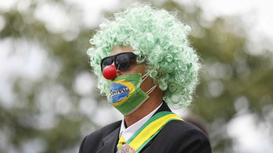 A supporter of the Brazilian President Jair Bolsonaro takes part in a protest against the National Congress and the Supreme Court while wearing a protective face mask to prevent the spread of the new Coronavirus in Brasilia, on March 15, 2020.