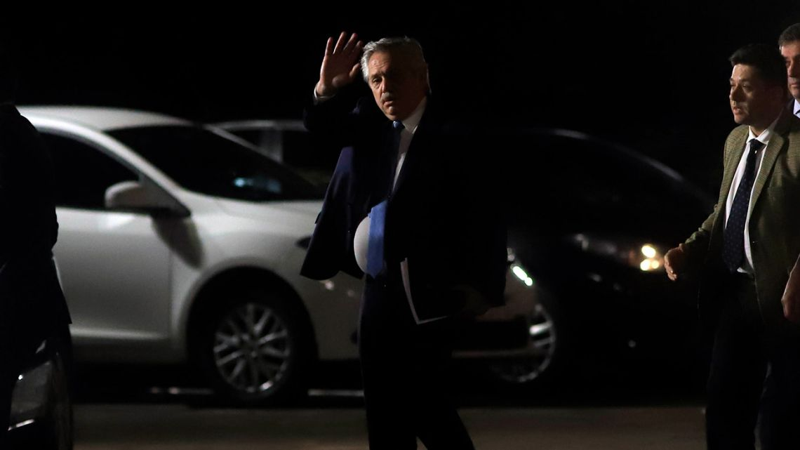 President Alberto Fernández leaves the Casa Rosada after a late-night meeting with opposition lawmakers.