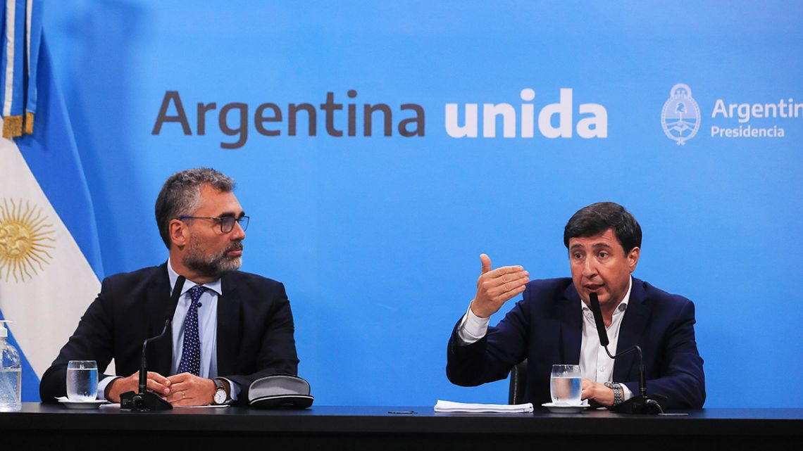 Social Development Minister Daniel Arroyo and ANSES chief Alejandro Vanoli give a press conference at the Casa Rosada.