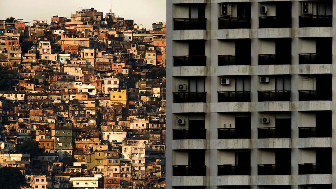 A view of the Rocinha favela, seen behind a building of Sao Conrado neighbourhood, one of the richest areas of Rio de Janeiro. As the spread of the new coronavirus COVID-19 accelerates in Brazil, the poor populations crammed into the often unsanitary homes and precarious health services in the favelas, are on great alert.