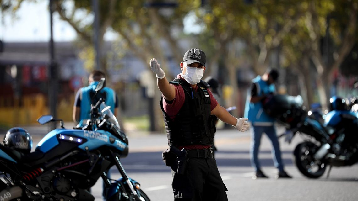 A police officer directs traffic at a roadblock in Buenos Aires, during the coronavirus pandemic.