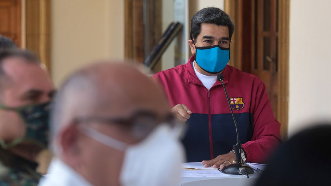 Handout picture released by Venezuela's Presidency, showing President Nicolás Maduro speaking during a televised announcement regarding the pandemic of the new coronavirus Covid-19, at Miraflores Presidential Palace in Caracas, on March 22, 2020.