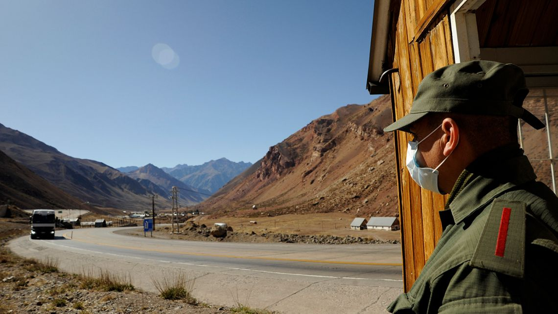 A security official wearing a face maskstands guard at the Horcones border crossing in Mendoza.