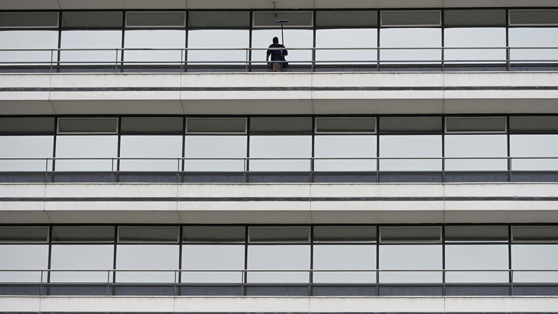 "A window cleaner is seen working during the ""preventative and compulsory"" lockdown of the population due to the pandemic outbreak of the new Covid-19 coronavirus in Buenos Aires, on March 25, 2020."