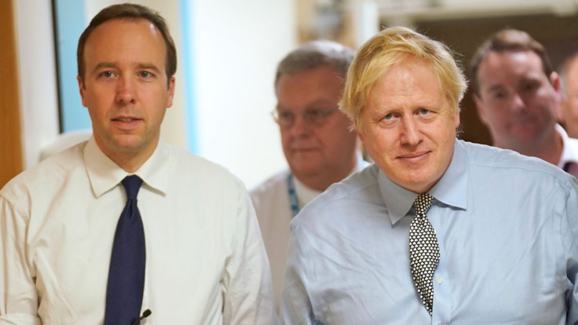 Britain's Prime Minister Boris Johnson, right, and Health Minister Matt Hancock, pictured in November 2019, have both tested positive for the new coronavirus.