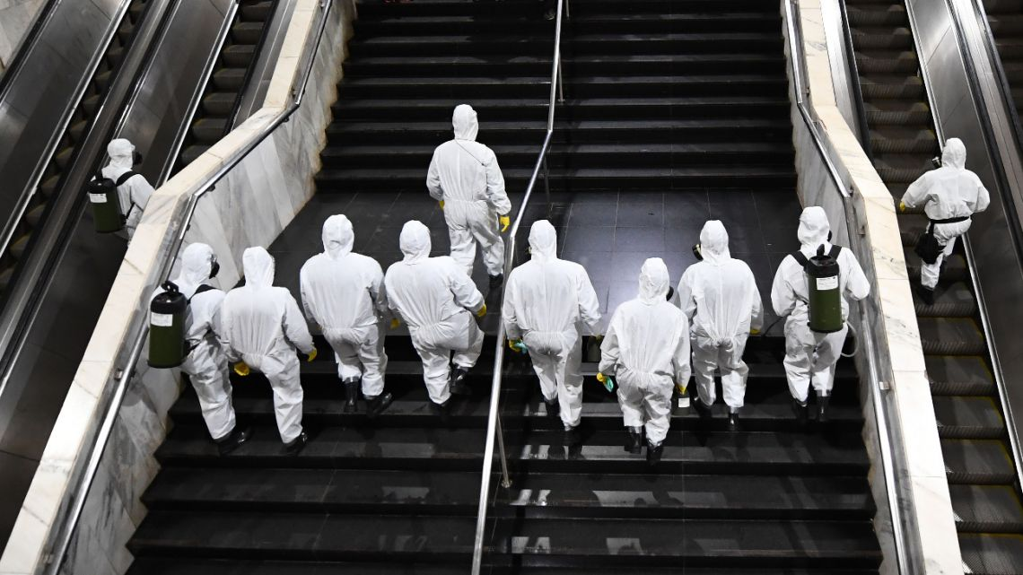 Brazilian soldiers enter the Subway Central Station for its disinfection, as a measure against the spread of the coronavirus, COVID-19, pandemic in Brasilia, early on March 29, 2020.