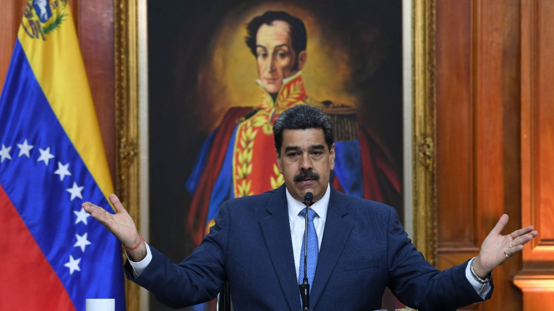 In this file photo taken on February 14, 2020 Venezuela's President Nicolas Maduro gestures during a press conference with members of the foreign media at Miraflores palace in Caracas.