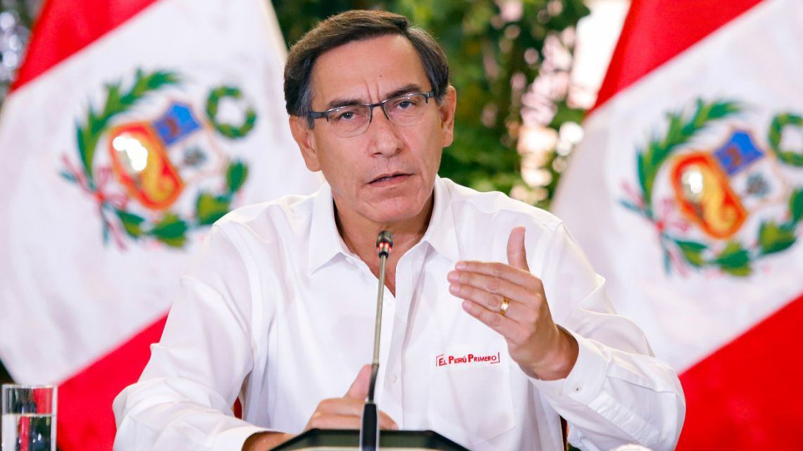President Martin Vizcarra announcing the extension of the lockdown to slow the spread of the novel coronavirus, COVID-19, until April 12, in Lima, on March 26, 2020.