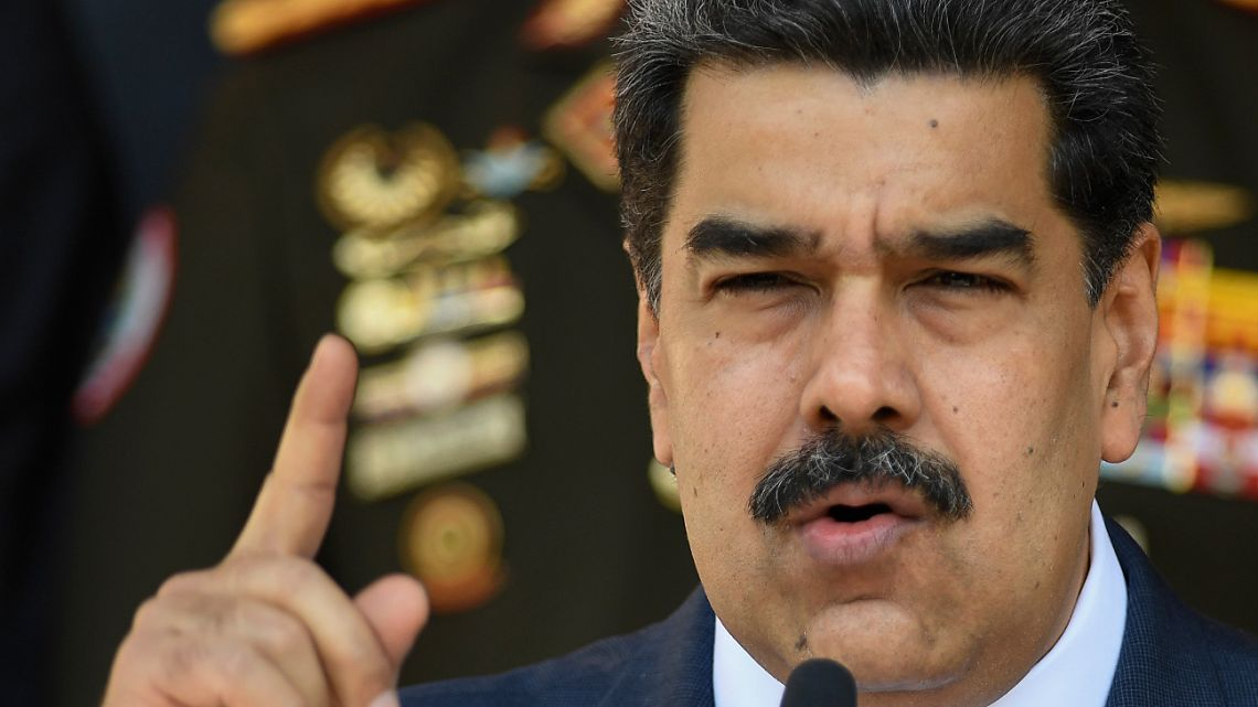 In this March 12, 2020, file photo, Venezuelan President Nicolas Maduro speaks at a press conference at the Miraflores Presidential Palace in Caracas, Venezuela.