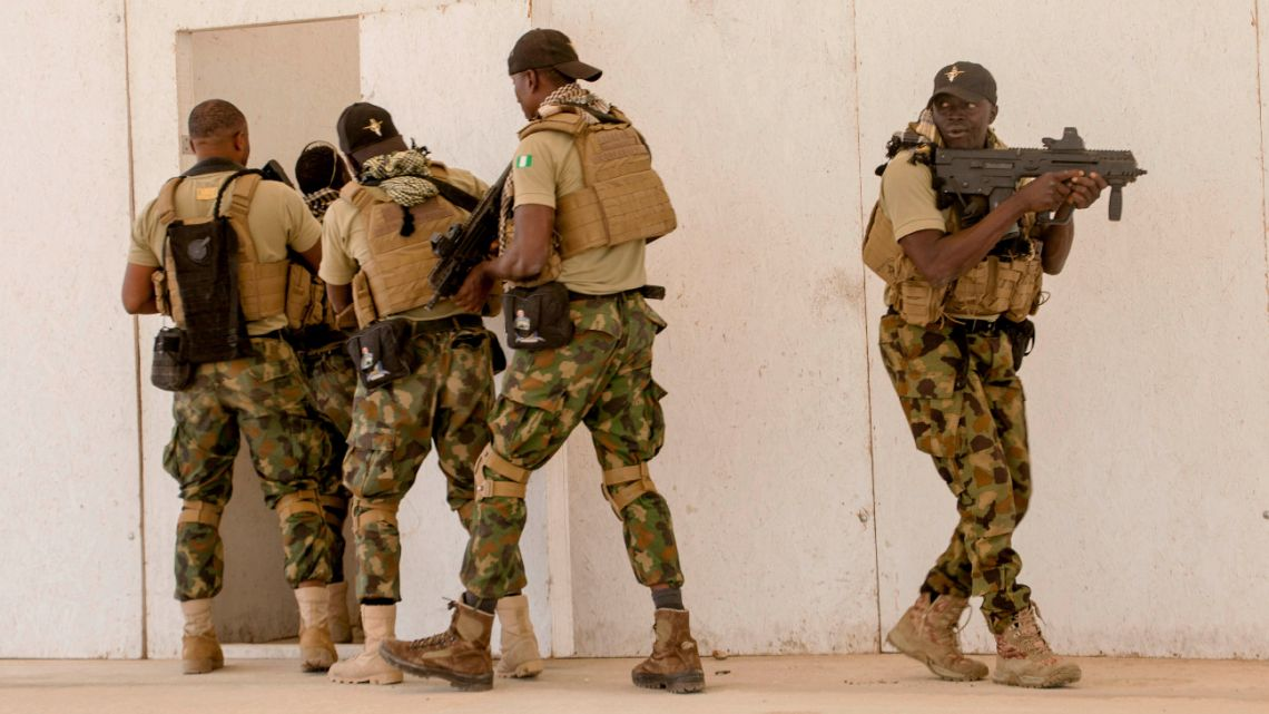 In this February 18, 2020, file photo, Nigerian Navy Special Boat Service troops exercise under the supervision of British special forces during U.S. military-led annual counter terrorism exercise in Thies, Senegal.