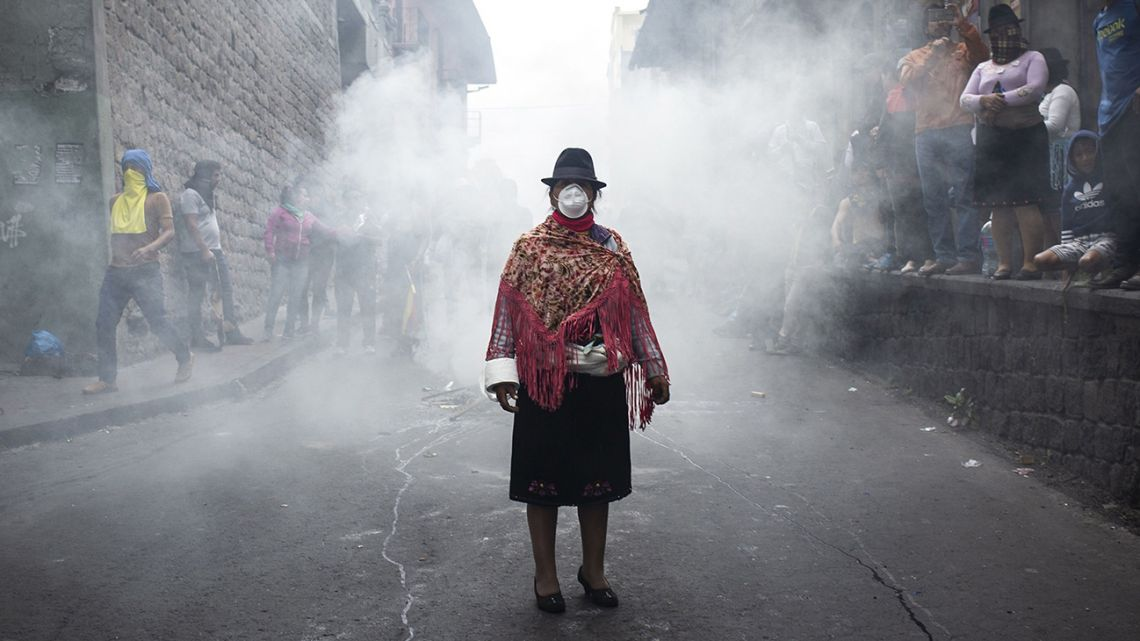 An indigenous woman wears a mask during a protest in Quito.