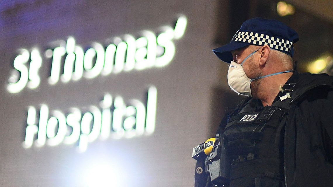 A police officer stands outside St Thomas' Hospital in central London as British Prime Minister Boris Johnson was moved to intensive care after his coronavirus symptoms worsened on Monday April 6, 2020. Johnson was admitted to St Thomas' hospital in central London on Sunday after his coronavirus symptoms persisted for 10 days. Having been in hospital for tests and observation, his doctors advised that he be admitted to intensive care on Monday evening. v