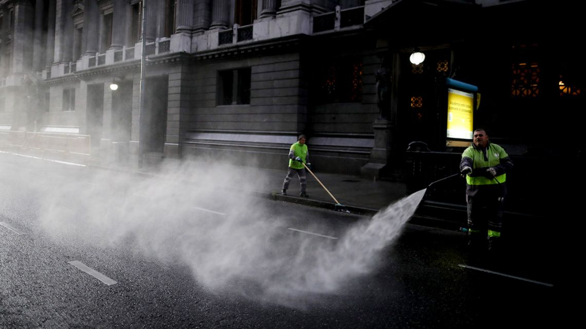 A worker disinfects the street outside Congress during the government-ordered lockdown to curb the spread of the new coronavirus.