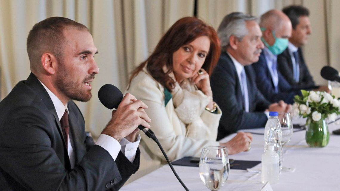 Handout photo released by Argentina's Presidency of the Economy Minister Martin Guzman (L) speaking next to vice-president Cristina Fernandez de Kirchner (2-L) Argentine President Alberto Fernandez (C,) Buenos Aires Mayor Horacio Rodriguez Larreta and legislator Sergio Massa during a working meeting with governors at the Olivos.