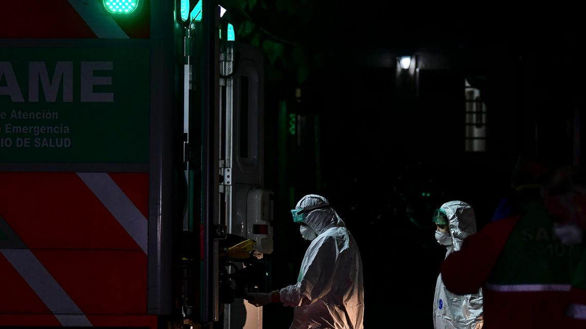 An elderly patient, allegedly infected with the new Covid-19 coronavirus, is taken from a nursing home to an ambulance of the Emergency Medical Care Service (SAME) in the Belgrano neighbourhood of Buenos Aires, on April 21, 2020.
