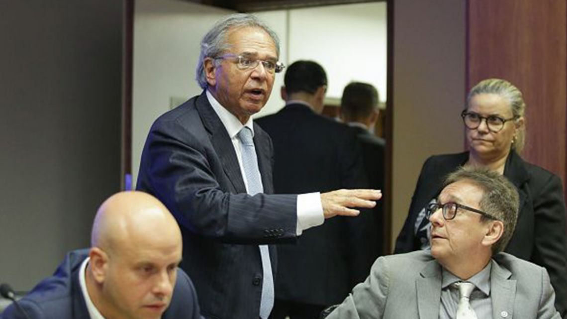 Paulo Guedes, Brazil's University of Chicago-schooled economy minister, oversees a meeting of Brazilian officials.