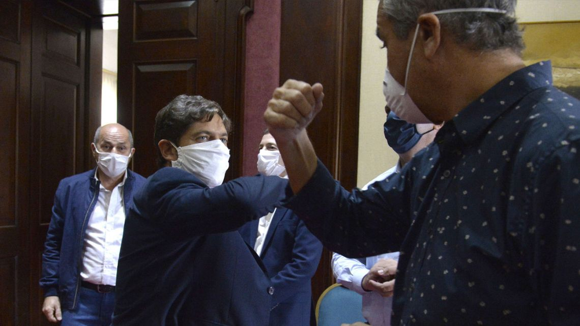 Buenos Aires Province Governor Axel Kicillof elbow-bumps a lawmaker at the La Plata provincial legislature.