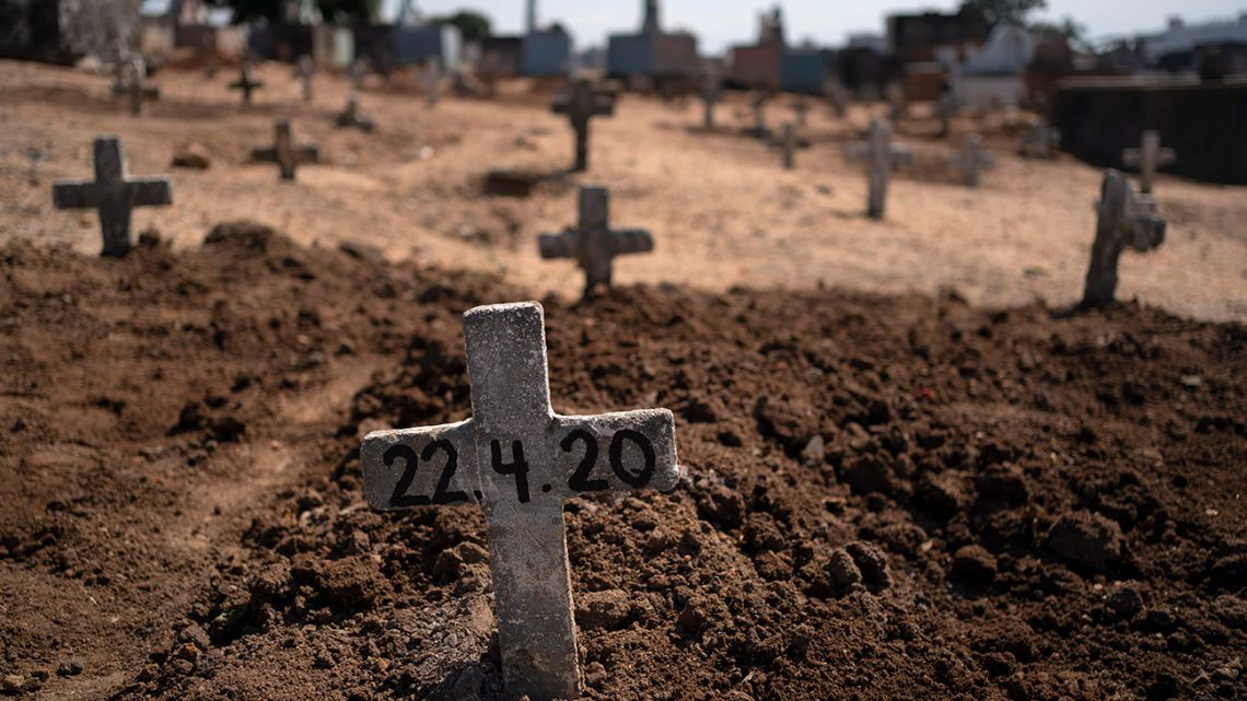 A cross with the date 22-4-20 marks the burial site of Edenir Rezende Bessa, who is suspected to have died of Covid-19, in Rio de Janeiro, Brazil, Wednesday, April 22, 2020. After visiting 3 primary care health units she was accepted in a hospital that treats new coronavirus cases, where she died on Tuesday.