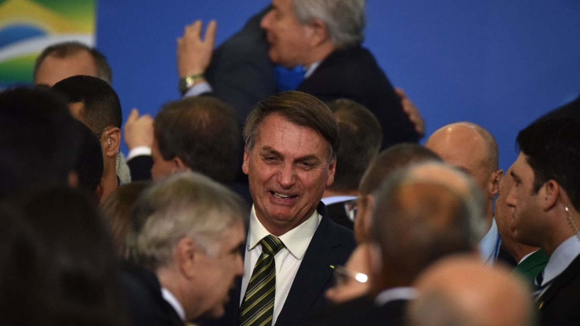 Jair Bolsonaro, Brazil's president, speaks with attendees during an inauguration ceremony for Andre Mendonca, Brazil's new minister of justice, at Planalto Palace in Brasilia, Brazil, on Wednesday, April 29, 2020.
