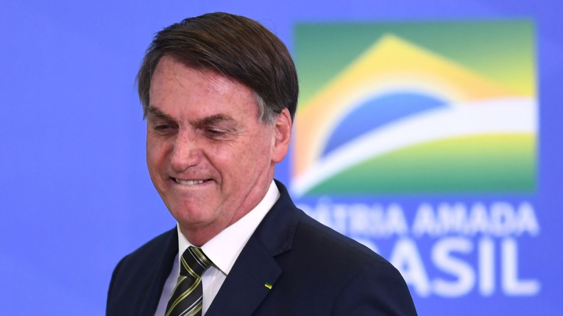 Brazilian President Jair Bolsonaro gestures during the inauguration ceremony of Andre Mendonca as new Justice Minister at Planalto Palace in Brasilia, on April 29, 2020.
