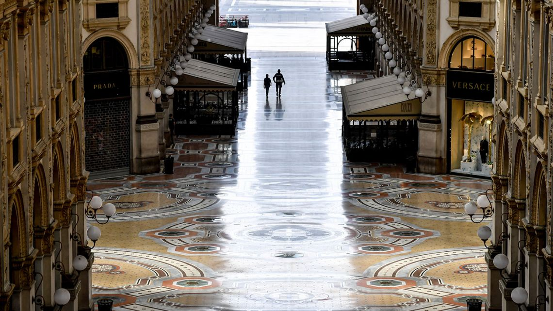 A view of the empty Galleria Vittorio Emanuele II shopping arcade following Italy's lockdown due to the Covid-19 emergency, in Milan, Italy, Thursday, April 30, 2020. Italy is in its eighth week of national lockdown, with some partial easing of restrictions on everyday life slated to take effect on Monday, with lifting of yet more limits set for later in coming weeks, on condition the rate of contagion doesn't sharply start rising again.