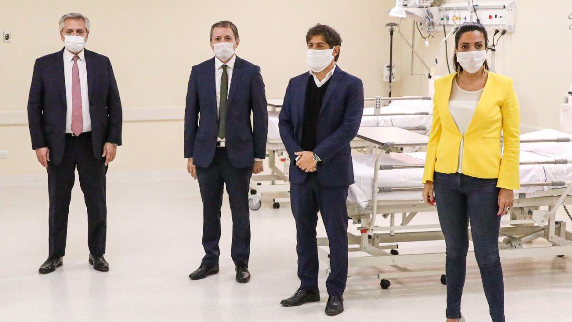 President Alberto Fernández (L), Echeverria Mayor Fernando Gray (2-L), Buenos Aires governor Axel Kicillof (2-R) and PAMI director Luana Volnovich posing at the Hospital de alta complejidad del Bicentenario on April 30, 2020 amid the COVID-19 outbreak.