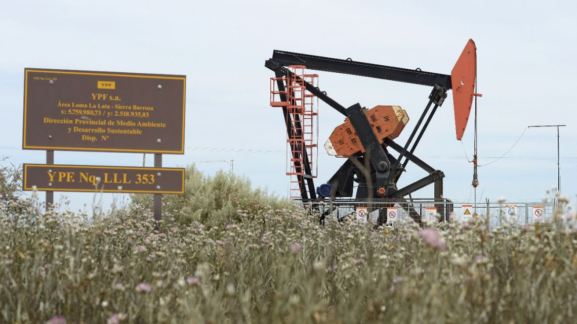 View of an Argentine oil company YPFs pumpjack to extract oil from a well at Loma La Lata, near Vaca Muerta Shale oil reservoir, in the Patagonian province of Neuquen on December 4, 2014.