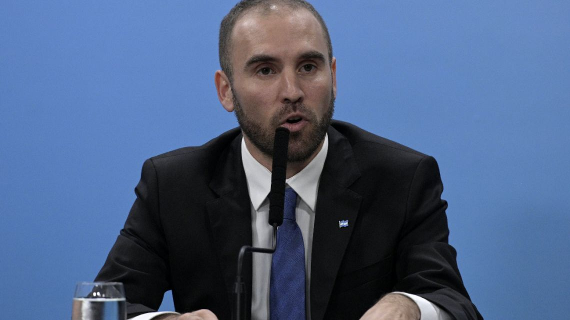 In this file photo Argentina's Economy Minister Martin Guzmán delivers a press conference at Casa Rosada announcing measures during the outbreak of the new Coronavirus, COVID-19, in Buenos Aires, Argentina on March 17, 2020.