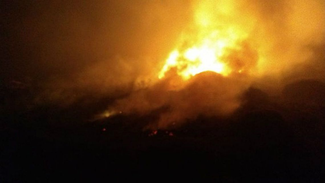 An image of flames, in Esquel, taken by a Twitter user (HERNÁN MERCÈRE, @HMERCERE) after the Leajet 35A crashed near Esquel late Tuesday evening.