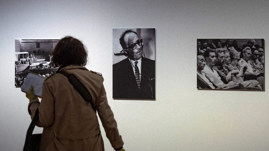 A visitor walks past a portrait of Nazi war criminal Adolf Eichmann (C) during his trial in Jerusalem at an exhibition on German-American philosopher and political theorist Hannah Arendt in Berlin on May 6, 2020.
