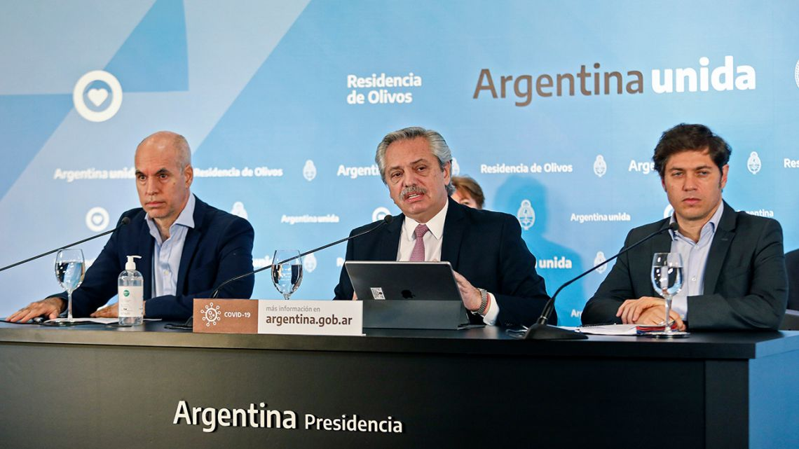 "Handout picture released by Presidency showing President Alberto Fernández (centre), flanked by Buenos Aires City Mayor Horacio Rodríguez Larreta (left) and Buenos Aires Province Governor Axel Kicillof, announcing the extension of the ""preventative and compulsory"" lockdown until May 24, amid the new coronavirus pandemic, at the Olivos presidential residence on May 8, 2020."