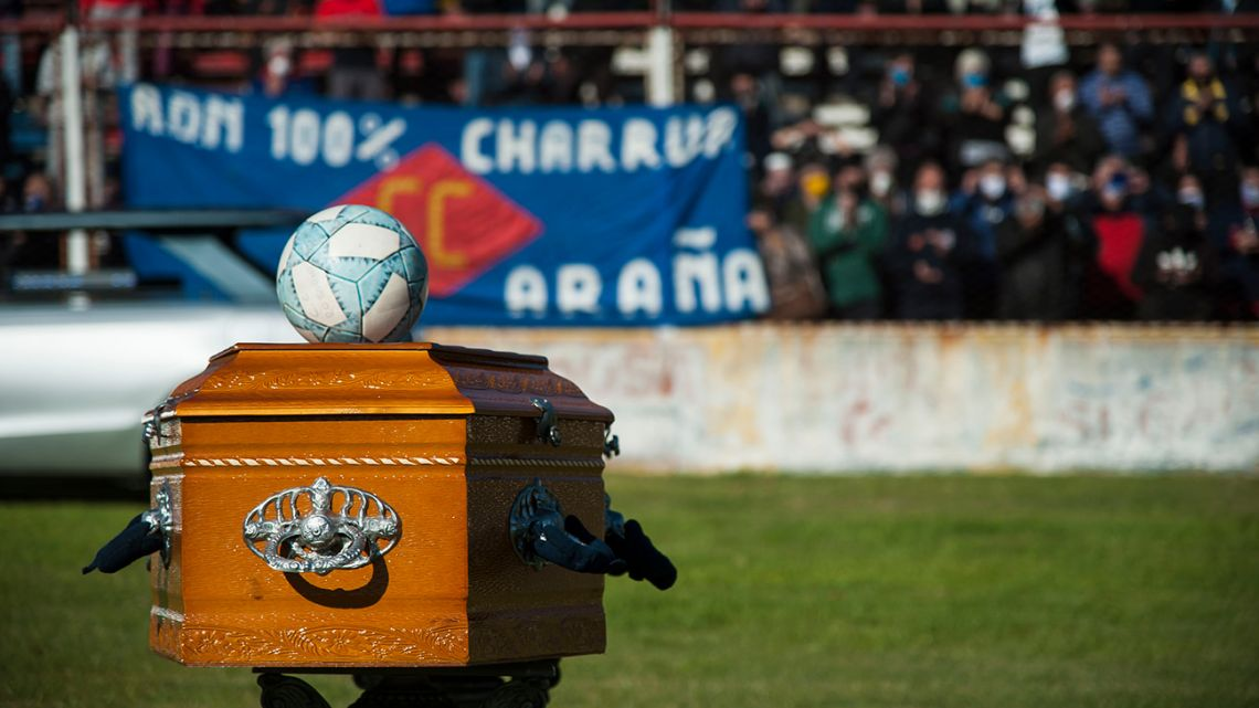 "Tomás ""El Trinche"" Carlovich's coffin, on display on the pitch at the Gabino Sosa stadium during a homage ceremony in Rosario."