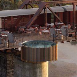 Algunos vagones fueron transformados en un restaurante y un bar, que se suman a una terraza construida sobre el puente, que posee una piscina circular que se asoma al vacío, con el río y la vegetación debajo.