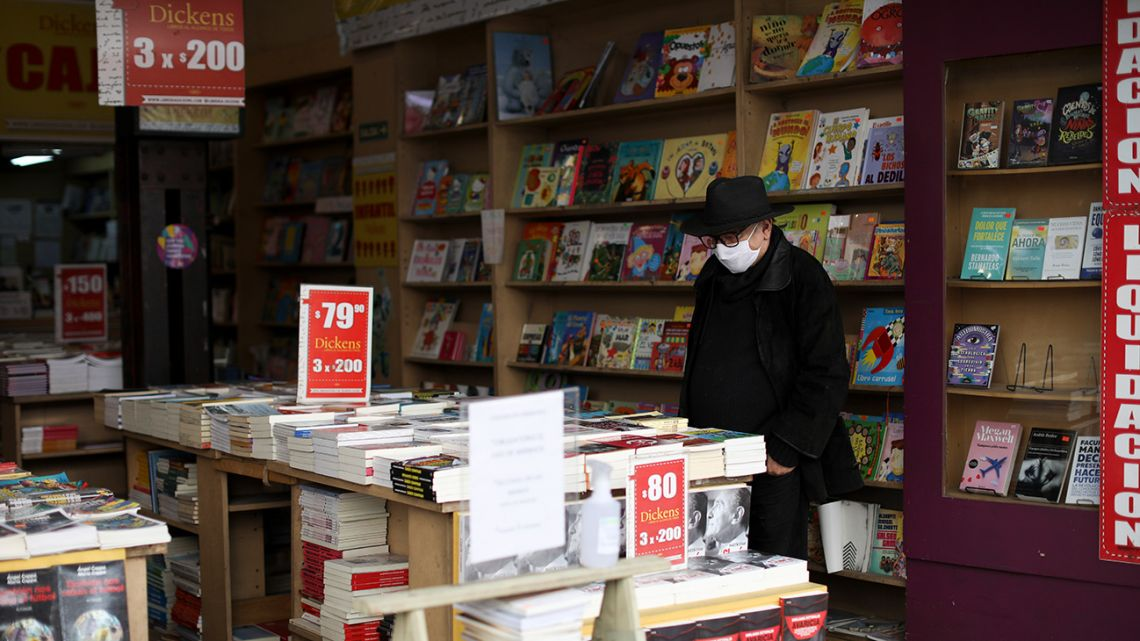 A man visits a reopened bookstore in Buenos Aires City.